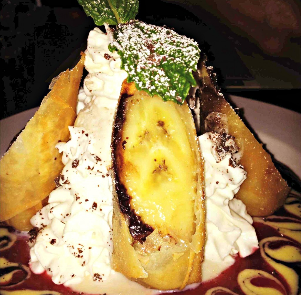 Banana Bomb: Tempura fried banana & dark chocolate wrapped in spring roll skin served with vanilla ice-cream, sliced almonds & assorted sauces
