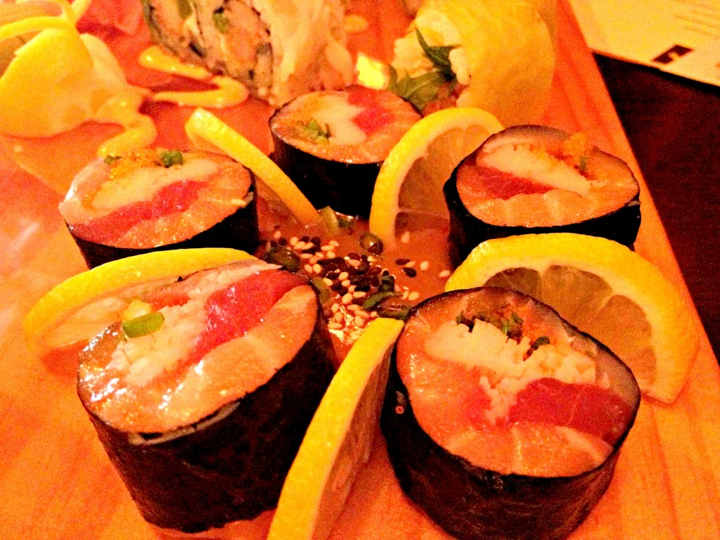 Sashimi Roll: Tuna, salmon, whitefish, crab, smelt roe, scallion, rolled in seaweed, served with sweet miso sauce