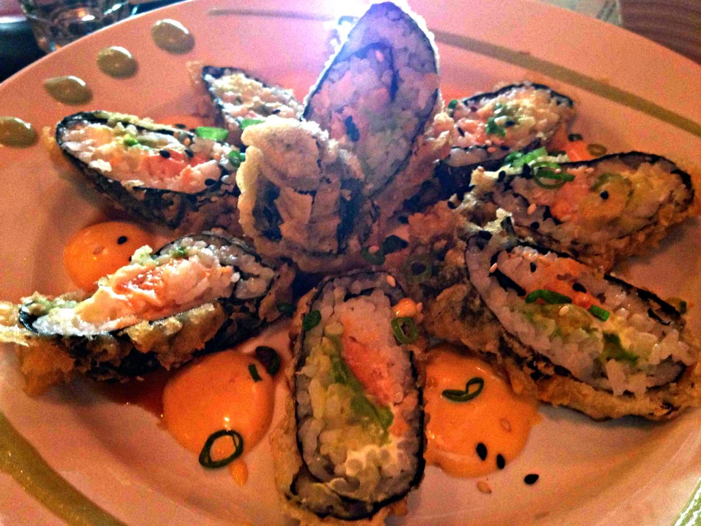 Tempura Bagel Roll: Smoked salmon, cream cheese, avocado and scallion, wrapped in seaweed and rice, served tempura style with eel sauce and spicy mayo