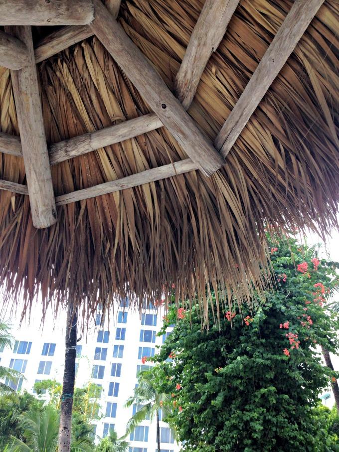 relaxing under a tiki hut is always a good idea
