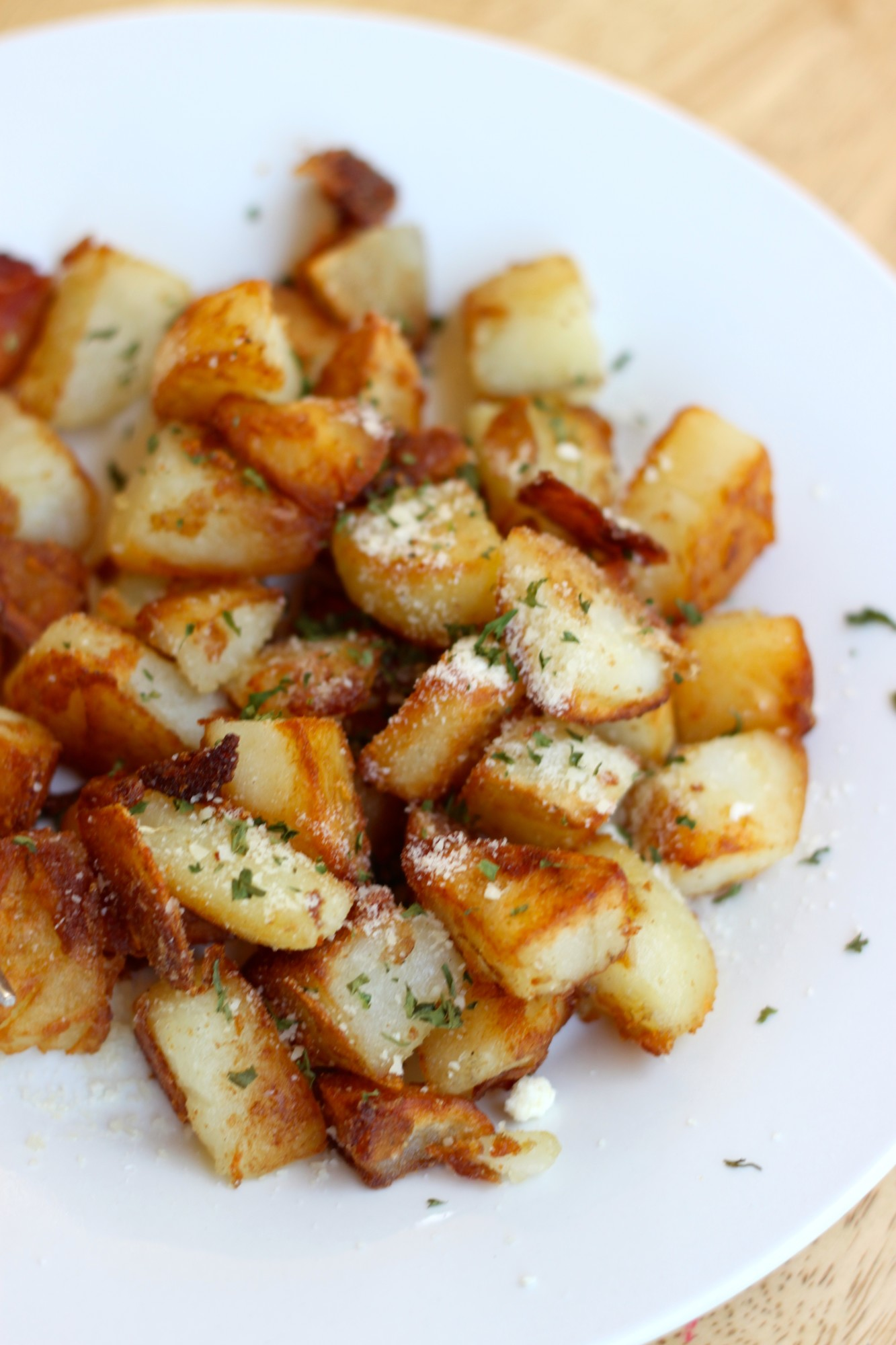The Best Pan Fried Breakfast Potatoes on table and dishes